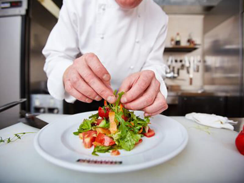 Illustrative image of chef preparing meal